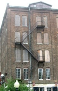 metal fire escape on brick mill