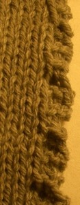 detail of knitted ruffle edging