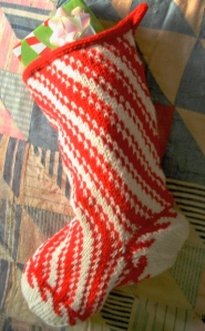 knitted Christmas stocking in red and white peppermint stripes