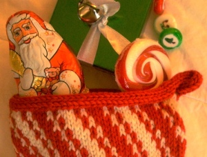 top of knitted red-and-white striped Christmas stocking