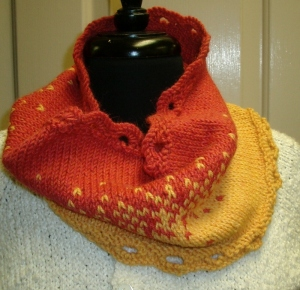 Knitted cowl in pink and yellow gradient