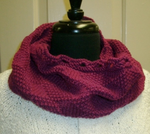 Knitted cowl in purple