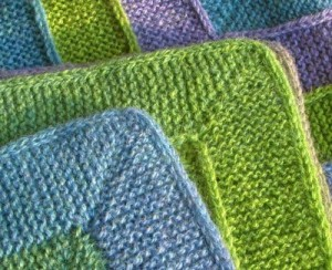 Knitted blanked with I-cord edging, here at corners