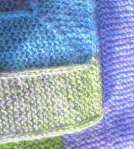 Knitted blanket with I-cord edging